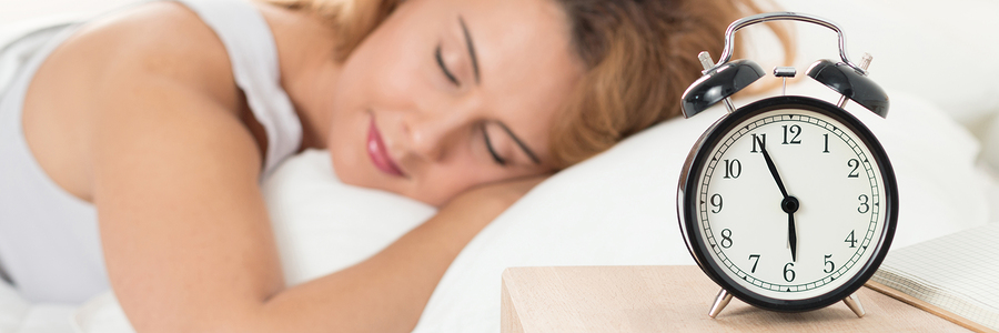 Beautiful happy woman sleeping in her bedroom in the morning. Well being and healthy sleeping concept. Letter box format